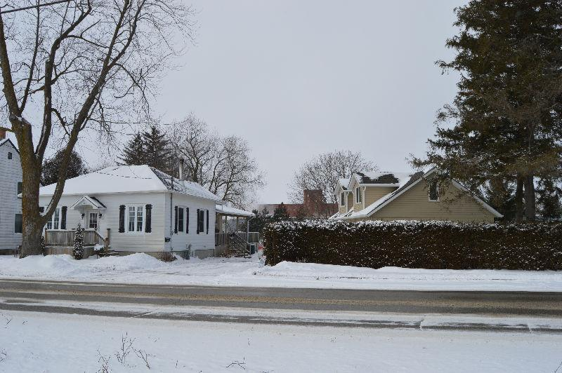 Charming 1 /2 Story home with finished, heated garage